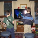 """This is """"Waiting for My Turn on Guitar Hero"""" at the New Year's Eve party. I never got to play. Some 20 different kids hogged the game the whole night. So much for """"Share, share, that's fair."""""""