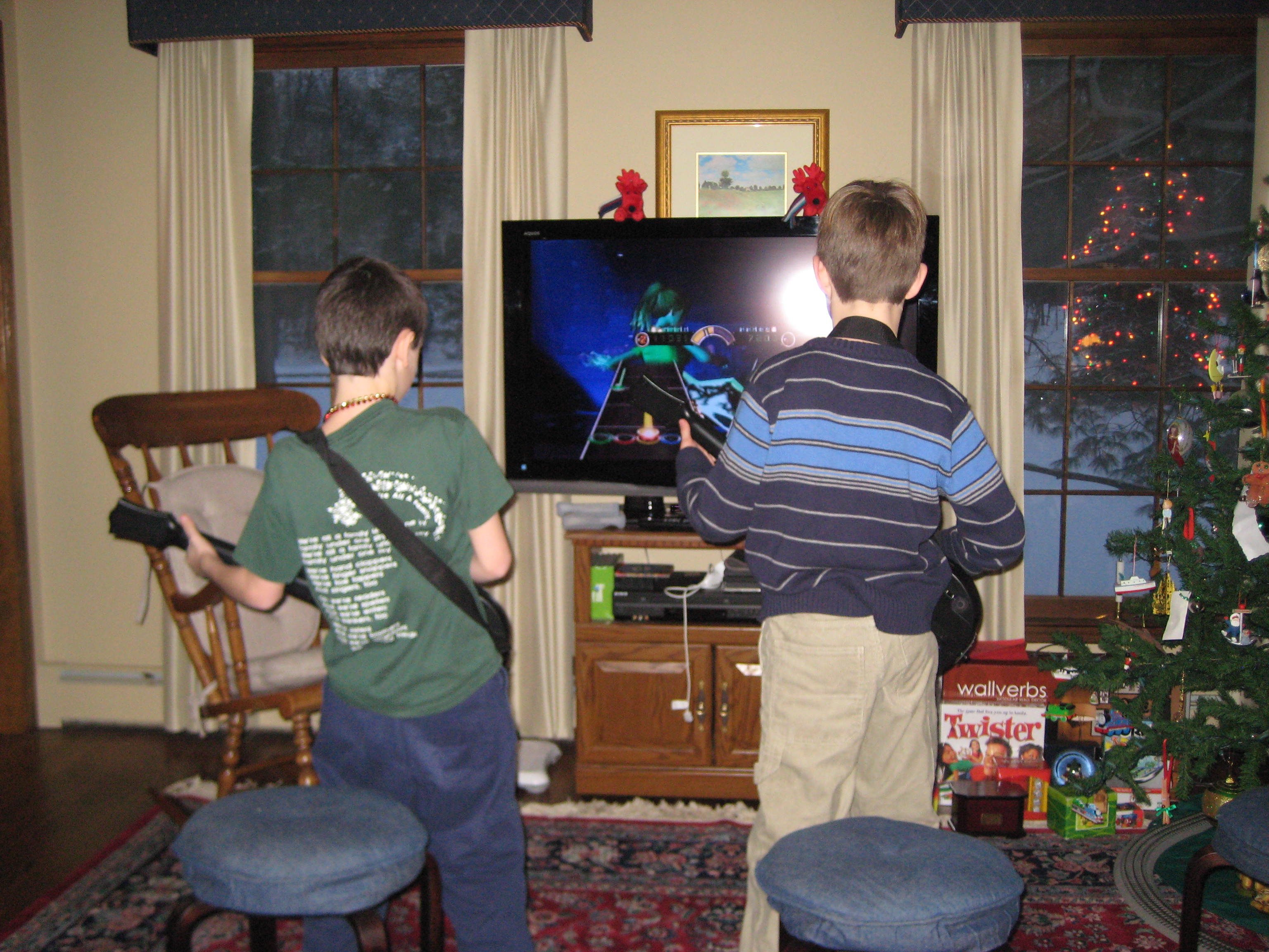 "This is ""Waiting for My Turn on Guitar Hero"" at the New Year's Eve party. I never got to play. Some 20 different kids hogged the game the whole night. So much for ""Share, share, that's fair."""