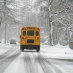 Shool bus driving in snowstorm