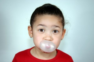 Girl blows bubble gum