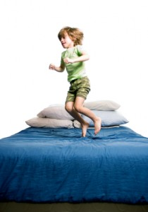 Kid jumps on bed