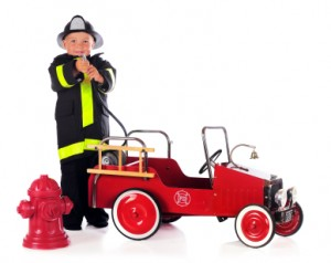 child with fire truck
