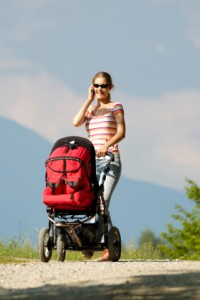mom on cell phone with stroller