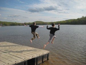 boys jump in lake