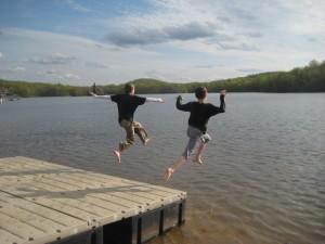 boys jump in lake