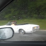Old Man Driving Top Down in a Hail Storm