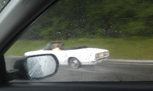 convertible top down in a storm
