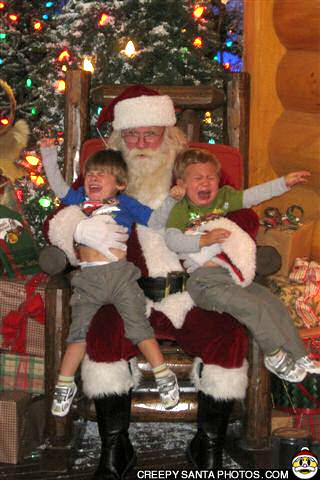 crying kids in santa's lap